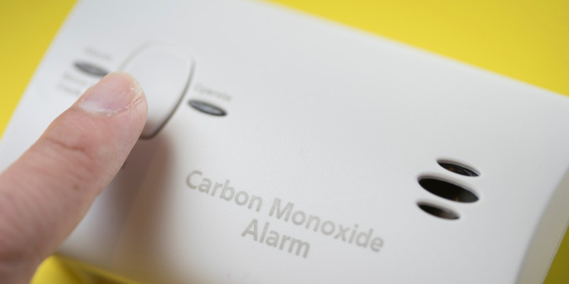 touching the carbon monoxide alarm